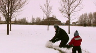Stock Video Footage of SnowMEN Father and Son Playing in the Snow