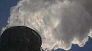 Stock Video Footage of Smoking stack of the thermal power station against a blue sky