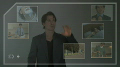 Male touching screen and moving around fragments of his life Stock Footage