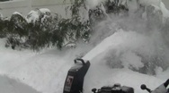 Stock Video Footage of Man Using Snow Blower in Deep Snow 1