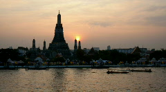 Stock Video Footage of Timelapse of sunset and dusk at Wat Arun in Bangkok, Thailand