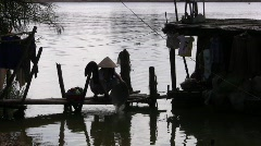Vietnamese Woman Washes by the Riverside Stock Footage