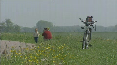 Father child picking flowers river dike 506001 014440 Stock Footage