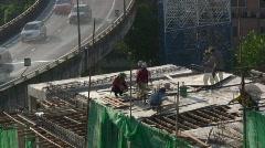 Asia Men Construction site development workers building skyscraper time lapse   Stock Footage