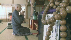 Buddhist monk praying Stock Footage