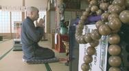 Buddhist monk praying Stock Footage