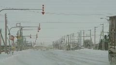 Cars and trucks moving in the snow Stock Footage