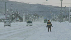 People and cars moving in the snow Stock Footage