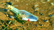 Letter in  Bottle on a Sand Stock Footage