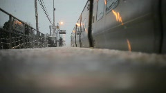 Train pulling into station in winter Stock Footage