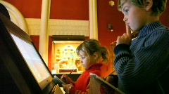 girl and boy looks at interactive display in museum - stock footage