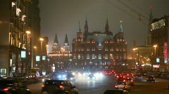 Moving cars in moscow night street, red square in background Stock Footage