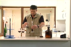 Winemaker measures and inspects blend NTSC Stock Footage