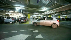 Cars turning on crossing in underground car park Stock Footage