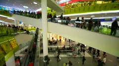 buyers crowd rushing on escalators in big multistorey mall shop - stock footage