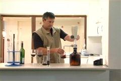 Winemaker measures water drops wide NTSC Stock Footage