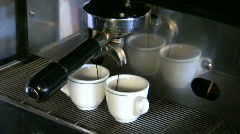 Espresso machine brewing coffee in bar Stock Footage