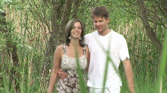 Girl and guy dating in the park - stock footage