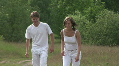 Couple Running And Hugging On A Glade Stock Footage