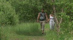 Girl and guy walking and talking in the nature Stock Footage