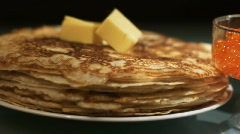 Dolly of pancake with red caviar 3 - stock footage