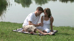 Lovers caressing on the shore Stock Footage