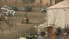 Fork lift Drives through a construction site Stock Footage