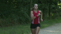 HD1080i Young athletic woman jogging in the black forest (Slow Motion) Stock Footage