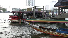 Passenger boats and urban riverside in Bangkok, Thailand.  Stock Footage