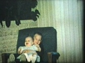 Brother And Sister In Rocking Chair (1966 - Vintage 8mm film) Stock Footage