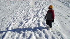 Trudging through snow Stock Footage