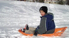 sledding wipeout - stock footage