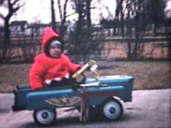 Little Boy Rides Car Outside (1964 - Vintage 8mm film) Stock Footage