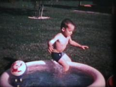Little Boy In Wading Pool (1965 - Vintage 8mm film) - stock footage
