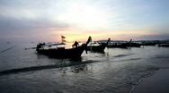 Stock Video Footage of Longtail boats on seashore at sunset