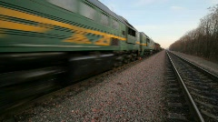 Freight train formation going on rails on gravel to camera Stock Footage
