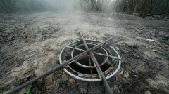 Steaming sewer manhole in forest Stock Footage