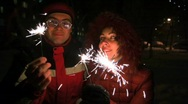 Stock Video Footage of young woman and man with sparklers, night outdoor