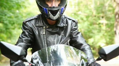 Biker on bikes moves on asphalt. Shooting close in front Stock Footage