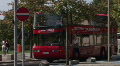 double-decker red bus rides on the street selective focus Footage