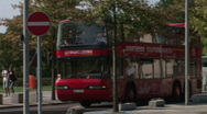 Double-decker red bus rides on the street selective focus Stock Footage