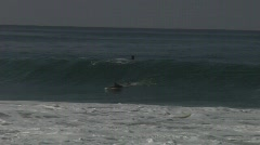 Surfer ride and bail Stock Footage