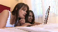 HD1080i Two young sexy woman on bed working with laptop indoor HD Footage