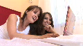 HD1080i Two young sexy woman on bed working with laptop indoor Footage