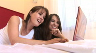 HD1080i Two young sexy woman on bed working with laptop indoor Stock Footage