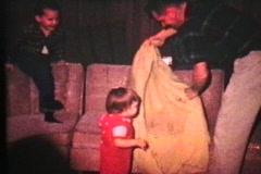 Little Girl Gets A Blanket Ride (1966 - Vintage 8mm film) Stock Footage