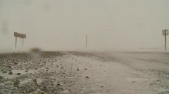 Weather, blizzard, snow blowing on empty highway Stock Footage