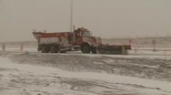 Snow plow truck on highway in snow storm Stock Footage