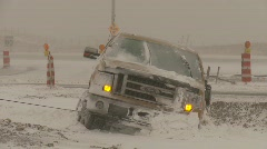 Weather, tow truck pulling pickup out of ditch, snow storm Stock Footage