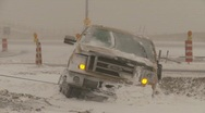 Stock Video Footage of weather, tow truck pulling pickup out of ditch, snow storm